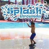 photo of child playing in splash grounds