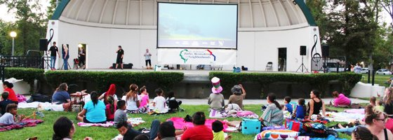 movie showing on large screen at park