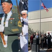 image of man holding U.S. flag for dedication ceremony