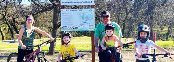 Image of family riding bikes