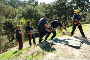 Firefighters Haul Basket Stretcher