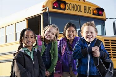 Safe-School-Alliance-for-web KIds in front of bus
