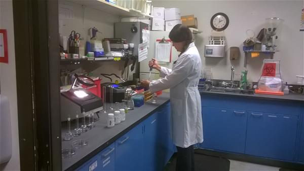 Utilities lab analyst tests water samples for constituents