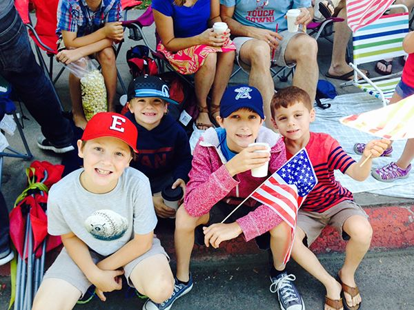Children watching 4th of July parade