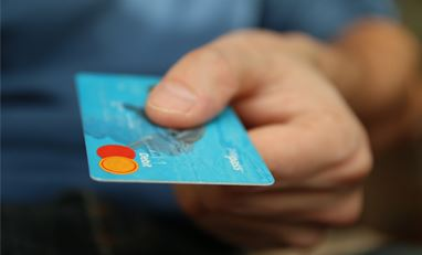 Credit Card in a man's hand