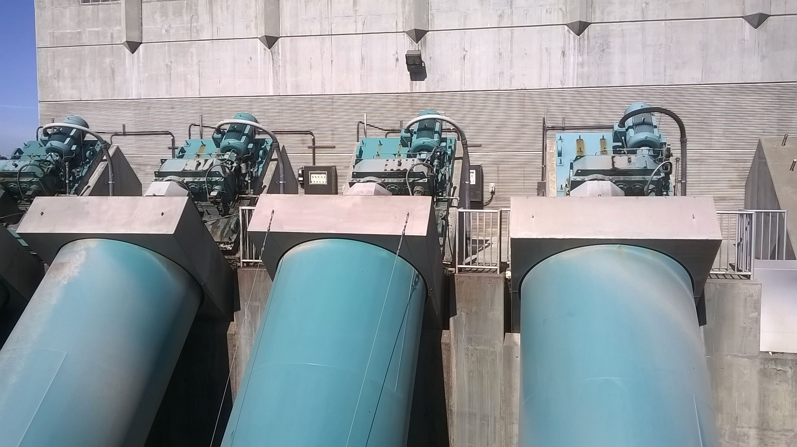 Four large screw pumps pull water up into the treatment facility