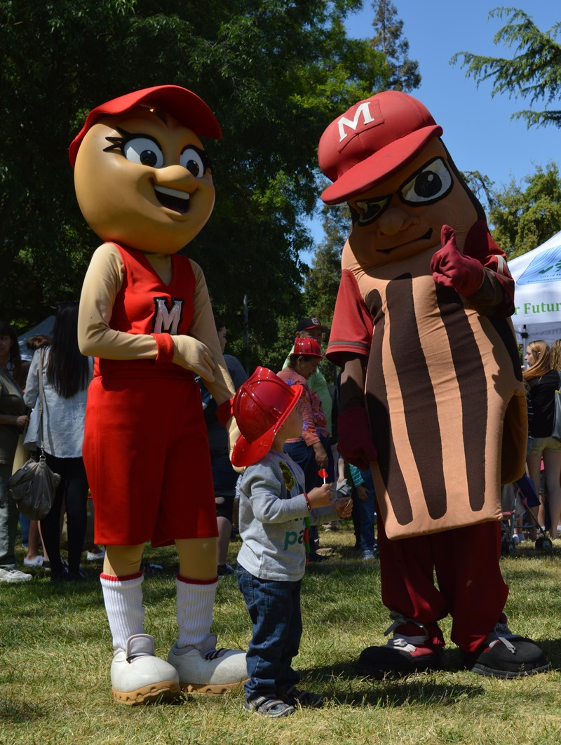 Mascots Teach a Small Child During the Earth Day E